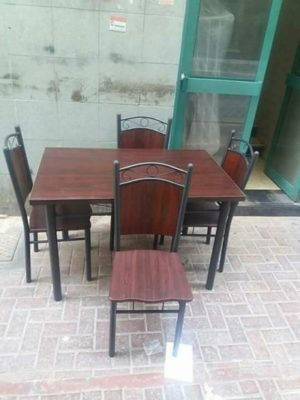 selling brand new 4 chair dining tables